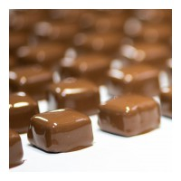 🚨Hold that chocolate—it's quiz time! 🚨 Only true Purdys super-fans will get this question right 😉. These freshly made caramels have just journeyed through our chocolate waterfall and are waiting for a sprinkling of salt.