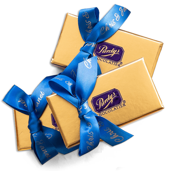 Favours wrapped in customized blue ribbon