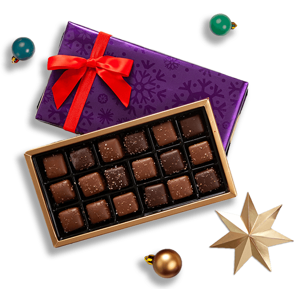An assortment of Purdys pre-wrapped chocolates in holiday wrapping paper